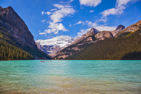louise: Banff National Park, Canada, Alberta. Magnificent Lake Louise with emerald green water surrounded by the Rocky Mountains, pine forests and glaciers Stock Photo