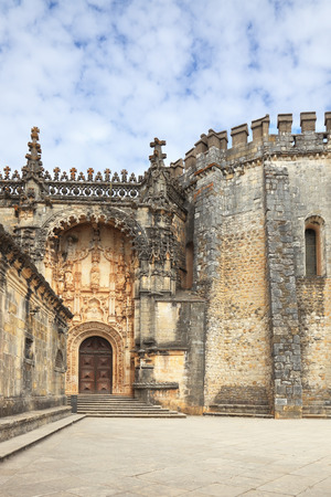 templars: The imposing medieval castle - the monastery of the Templars. The main entrance and the ornate arch, combined with a round tower