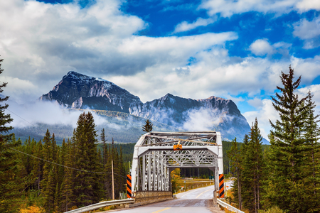 jasper: Bridge over the river in the picturesque mountain reserve.  Canadian Rocky Mountains, Jasper National Park