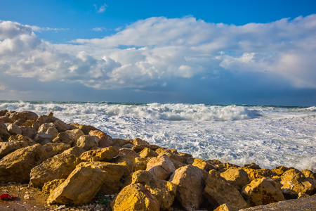 foaming: Tel Aviv in January. New Quay in the Old Jaffa in winter storm. Huge foaming waves of the Mediterranean beat against the shore Stock Photo