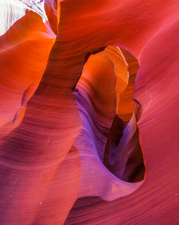 slot canyon: Beams of the midday sun fancifully light slot - canyon Antelope Stock Photo