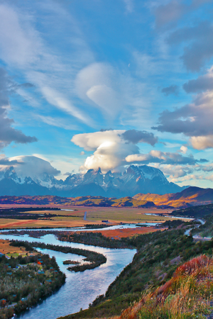 serrano: Mad wind over Patagonia. Striking clouds over the rocks  Los Kuernos and Valley Serrano Stock Photo