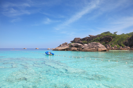 inflatable boat: Exotic tropical Similan Islands. Clear azure ocean water. Moored in the bay inflatable boat
