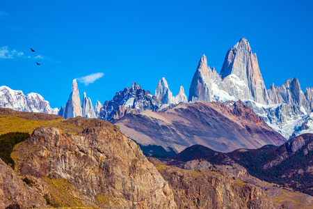 fitzroy: Amazing Patagonia in February. Fitzroy Mountains covered midday sun