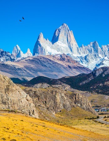 el chalten: Amazing Patagonia in February. The white tops of Fitzroy rocks covered the midday sun.