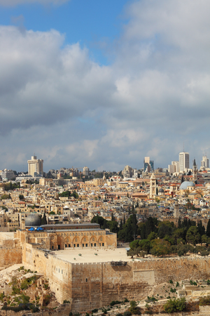 omar: Holy City of Jerusalem. The magnificent panorama of the city. Omar Mosque and the Dome of the Holy Sepulcher. In the background - modern skyscrapers and cranes newly