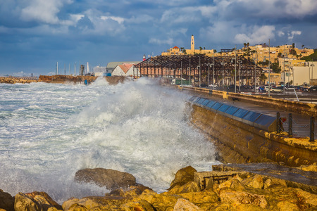 gale: New Quay in the Old Jaffa, Israel. Whole gale in the Mediterranean Sea. Huge foamy waves fight about the coast Stock Photo