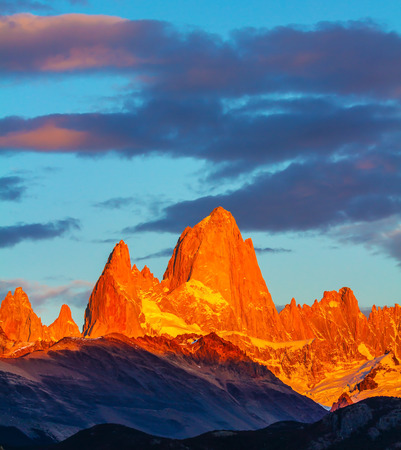 fitz roy: Blood-red sunset illuminates the top of impressive cliffs Fitz Roy. The stunning Patagonia Stock Photo