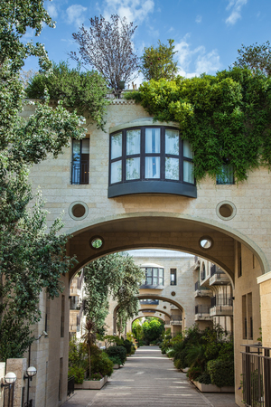 arched: Elegant arched passageway between buildings. Jerusalem, Israel Stock Photo