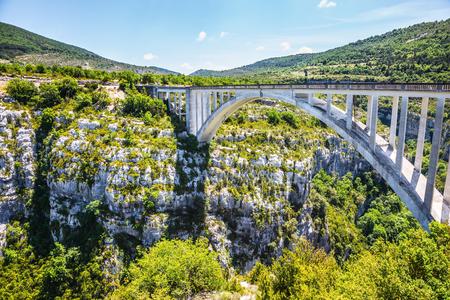 tributary: The white bridge over tributary of the river Verdon Artuby. The largest alpine canyon Verdon. Canyon of Verdon, Provence, France