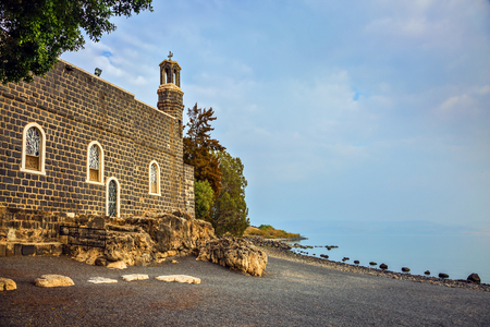 primacy: Sea of Galilee in Israel. Jesus then fed with bread and fish hungry people. The Church of the Primacy - Tabgha on the Sea Gennesaret Stock Photo