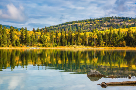 rockies: Autumn in Jasper Park, Canadian Rockies. Charming Patricia Lake amongst the evergreen forests, yellow bushes and mountains