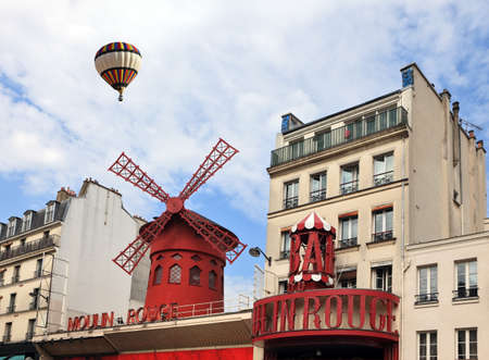 rouge: Big balloon flies over the Parisian cabaret Moulin Rouge. Red Tower, mill wings and the words Moulin Rouge.