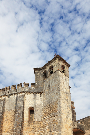 templars: The imposing medieval castle - the monastery of the Templars. Powerful round tower and bell tower Editorial