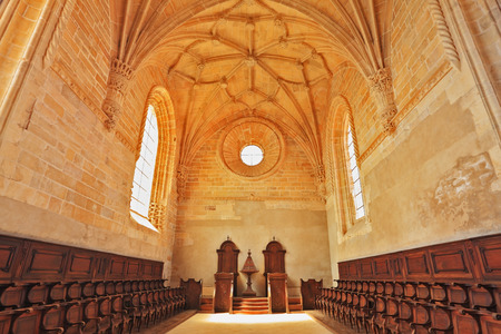 templar: The imposing medieval castle of the Knights Templar in Portugal. The magnificent chapel with a vaulted ceiling and rows of oak chairs