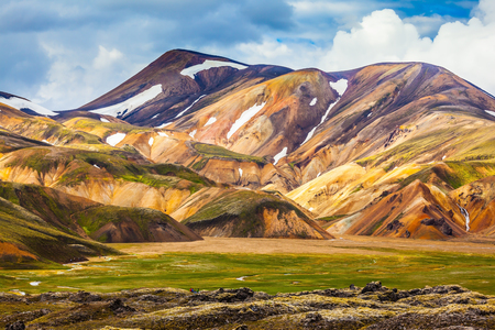 snow fields: National Park Landmannalaugar. On the gentle slopes of the mountains are snow fields and glaciers. Magnificent Iceland in the July Stock Photo