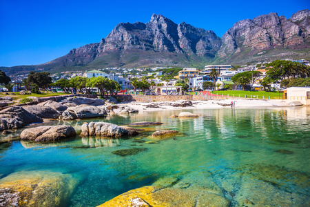 Panorama of Cape Town, South Africa. The city beach against magnificent mountains Фото со стока