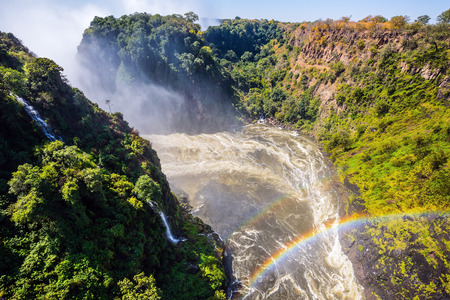 zambezi: After the rainy season, the waterfall most high water. The famous Victoria Falls on the Zambezi River in South Africa