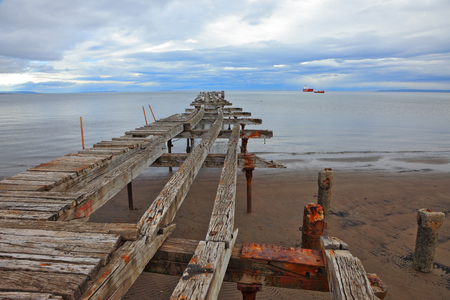 magellan: Old dilapidated pier in the Strait of Magellan. Corroded bearings and collapsed wooden flooring