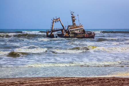 Skeleton Coast in Namibia. The ship is stranded or grounded many years ago. Rough surf of the Atlantic