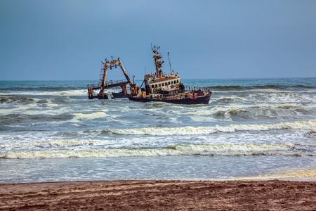 Skeleton Coast in Namibia. The ship crashed many years ago. Rough surf of the Atlantic Stock Photo
