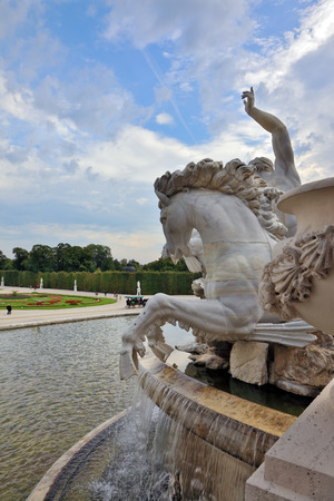 habsburg: Schönbrunn - the summer residence of the Austrian Habsburg emperors. Elegant fountain and a white marble statue of a horse