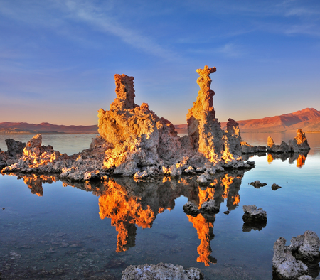 calcareous: Mono Lake - a natural wonder in the United States. Outliers - bizarre limestone calcareous tufa formation  reflected in the smooth water.