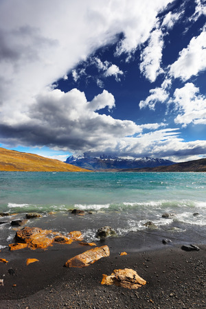 National Park Torres del Paine. Patagonia, Chile. Stormy wind blows the clouds over the lake Laguna Azul
