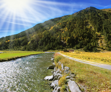 glows: Austrian Alps. Headwaters of the famous Krimml waterfalls. Crystal clear water glows in the midday sun.