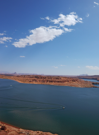 motorboats: . Superb huge and beautiful Lake Powell. Motorboats cut the smooth water of the lake