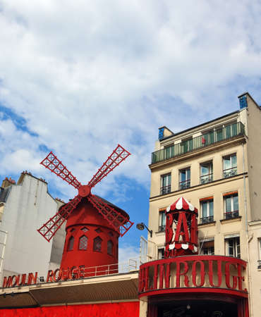 moulin: Parisian cabaret Moulin Rouge. Red tower, mill wings and inscription Moulin Rouge. Nearby - a picturesque turret with an inscription of Bars