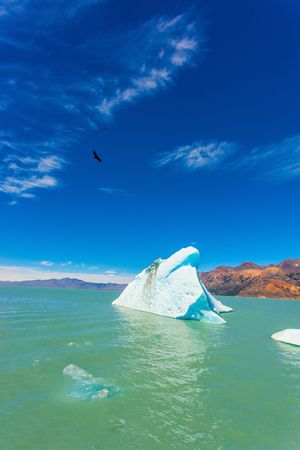 large formation: Argentina Patagonia, emerald water of the lake Viedma. Huge white-blue ice floe drifts from coastal glacier Stock Photo