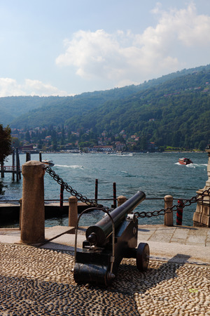 groomed: The ancient gun decorates quay in beautiful well-groomed park on island Izola Bella