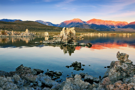 calcareous: The magic of Mono Lake. Outliers - calcareous tufa formation  on the smooth water of the lake. Orange sunset