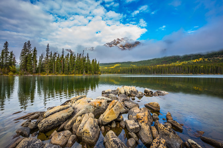 rockies: Small island in Lake Pyramid. Cold autumn day in the Canadian Rockies. The concept of tourism and vacation Stock Photo