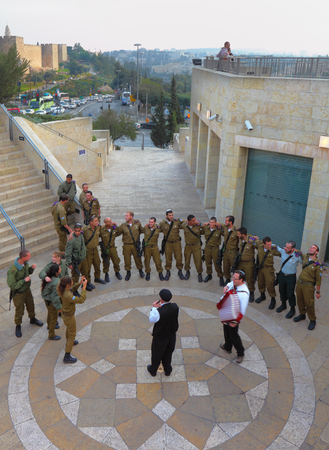 accompaniment: JERUSALEM - DEZEMBER 10 - IDF soldiers are dancing near the walls of ancient Jerusalem.   10 Dezember 2010 in Jerusalem, Israel. Accompaniment - flute and accordion