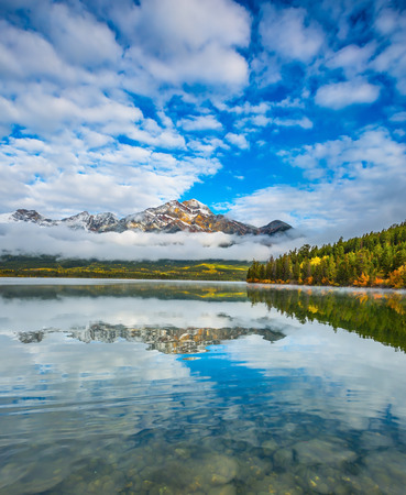 canadian rockies: The Pyramids Lake in Canadian Rockies. Cold autumn morning. Concept  of vacation and tourism Stock Photo