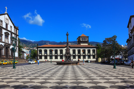 memorial cross: FUNCHAL, MADEIRA - OCTOBER 08, 2011: The main square of the city. Before administration building stands a memorial monument