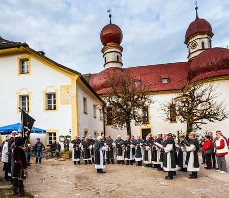 catholic chapel: KONIGSSEE, BAVARIA, GERMANY - OCTOBER 4, 2013: Monastic Choir performs ritual chants.  Catholic chapel in Baroque style. Church of St. Bartholomew at Lake Königssee Editorial