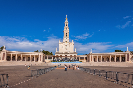 colonnade: Catholic Cathedral, bell tower and colonnade in Fatima, Portugal Stock Photo