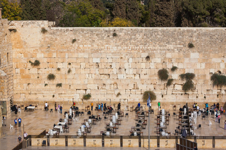 sukkoth festival: The area in front of the greatest shrine of Judaism. The Western Wall of the Temple is preparing for evening prayer