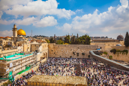 sukkoth festival: Western Wall of the Temple. The huge crowd of Jews for a prayer has gathered on the square. Autumn holiday of Sukkot in Jerusalem
