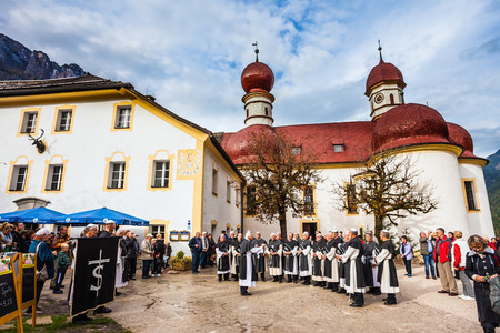 catholic chapel: KONIGSSEE, BAVARIA, GERMANY - OCTOBER 4, 2013: Monastic Choir performs ritual chants. Church of St. Bartholomew at Lake Königssee. Catholic chapel in Baroque style