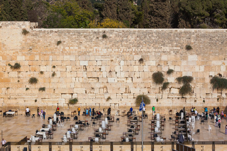 sukkoth festival: Autumn holiday Sukkot. The area in front of the greatest shrine of Judaism. The Western Wall of the Temple is preparing for evening prayer Stock Photo