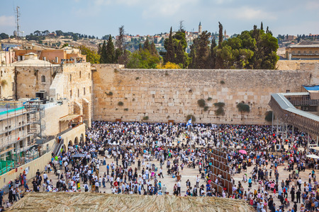 sukkoth festival: The Western Wall of the Temple. Autumn holiday of Sukkot in Jerusalem. At Temple Square was a huge crowd of Jews