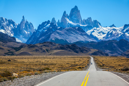 fitz: Fine concrete highway to the majestic Mount Fitz Roy. Sunny autumn day in February. Argentine Patagonia