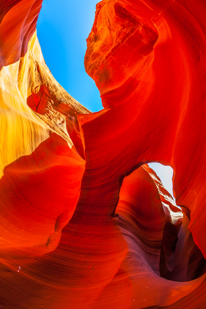 Fantastic slot canyon Antelope in the Navajo reservation. Fantastic play of light and color in red tunnel. Arizona, USA