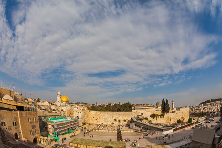 The area of the Western Wall of the Temple after the prayer. Autumn holiday of Sukkot. Windy autumn day Editorial