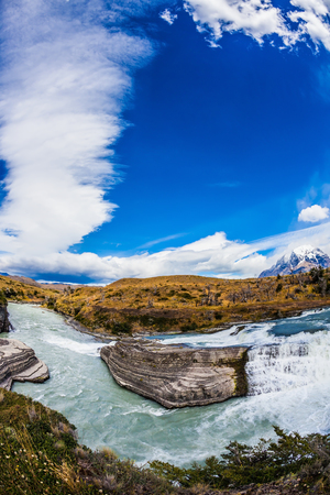biosphere: Chile, Patagonia, Paine Cascades. Rocky ledges Paine river forms a cascading waterfalls. Torres del Paine National Park - Biosphere Reserve Stock Photo