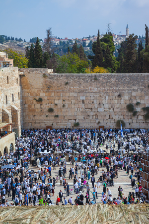 sukkoth festival: Autumn holiday of Sukkot in Jerusalem. The western wall of the Temple. Huge crowd of Jews gathered for prayer on the square